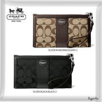 COACH★LEGACY ZIPPY WALLET IN SIGNATURE FABRIC