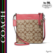 COACH★LEGACY NORTH/SOUTH SWINGPACK IN SIGNATURE FABRIC