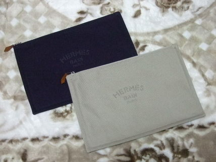 In the VERY post sold out HERMES Pouch clutch