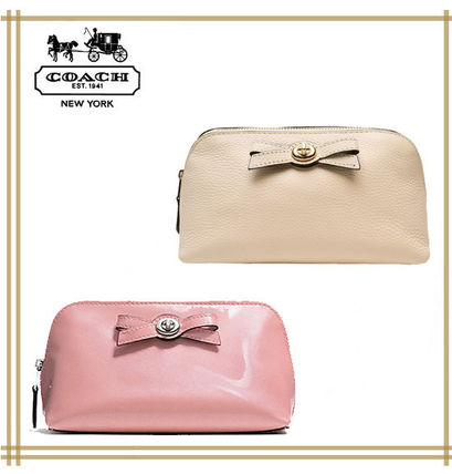 COACH★TURNLOCK BOW COSMETIC CASE F53423 国内発送! 関税込