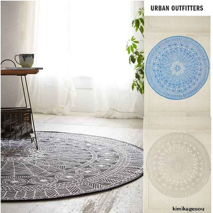 * Urban Outfitters a nice round rugs