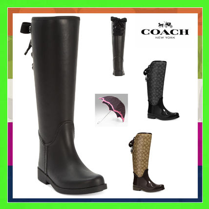 """"" Coach lace-up rain boots"