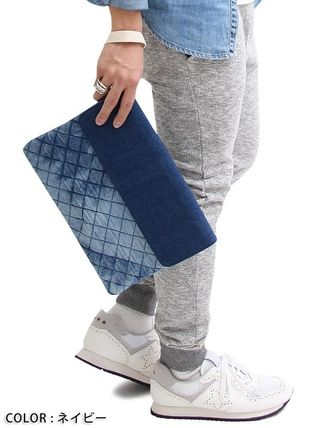 Shipping quilted denim clutch bag all