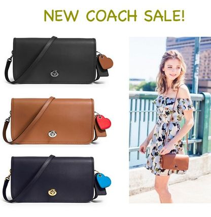 Limited coach turn lock cross-body bag