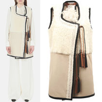 16-17AW C124 SHEARLING PATCHWORK GILET WITH LEATHER TASSELS