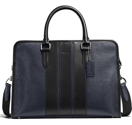 COACH bond brief bag is color-block