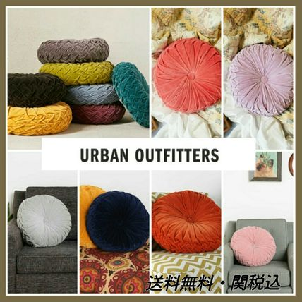 * UrbanOutfitters * round pin tuck cushion