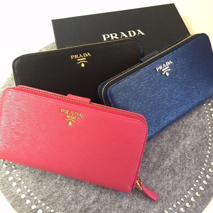 And PRADA button round ZIP multiple colors
