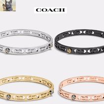 Coach(コーチ) アンクレット Coach/DAISY rivet pierced kissing c バングル