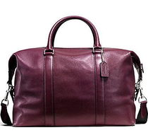 オックスブラッドCOACH VOYAGER BAG IN PEBBLE LEATHER F93596