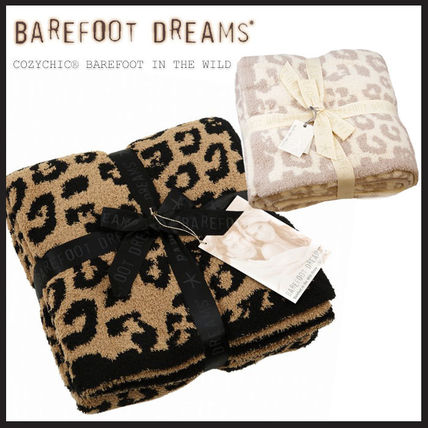 Barefoot Dreams In The Wild Leopard Receiving the Throw