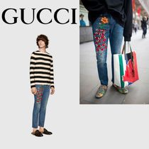GUCCI EMBROIDERED SNAKE FLOWER TAPERED DENIM JEANS
