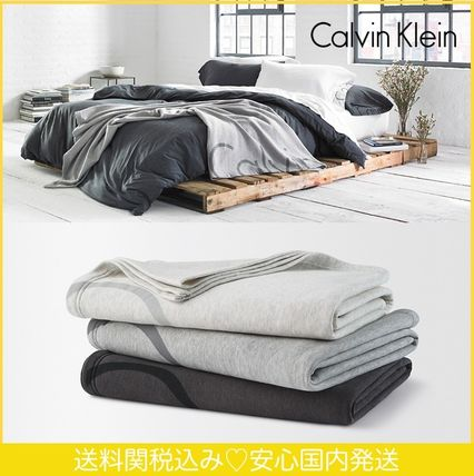 In the Calvin Klein gift with logo blanket