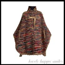 Oversized tweed cape