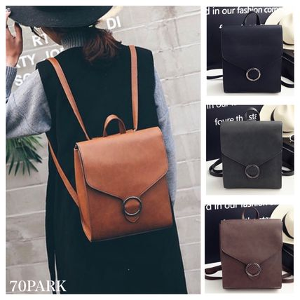 Circle buckle PU leather backpack all Luc A4