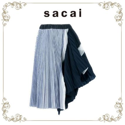 No. 25 ans s SACAI pleated asymmetric skirt