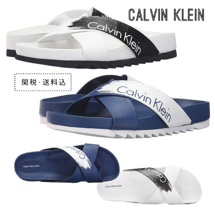 Calvin Klein logo with two-tone sandals