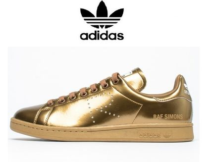 Rare sold out almost AdidasxRaf Simons Stan Smith gold