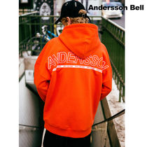 ANDERSSON BELL(アンダースンベル) パーカー Andersson Bell★UNISEX ARCH LOGO EMBROIDERY HOODIE-ORANGE