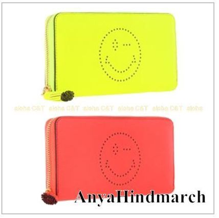 Wink Smiley long wallet on into AnyaHindmarch Ahnya