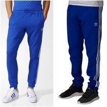 ファレル コラボ!! adidas PHARRELL WILLIAMS HU TRACK PANT