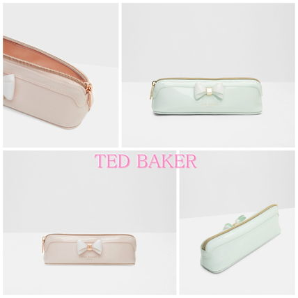 2-3 days to the TED BAKER presents popular Ribbon Pouch
