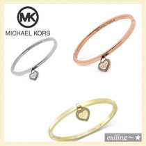 セレブ愛用者多数☆Michael Kors☆Tone Bangle with MK Charm