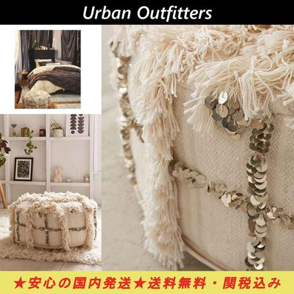 Urban Outfitters fringe and sequins cylinder cushion