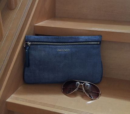Last one leather denim clutch Jimmy Choo