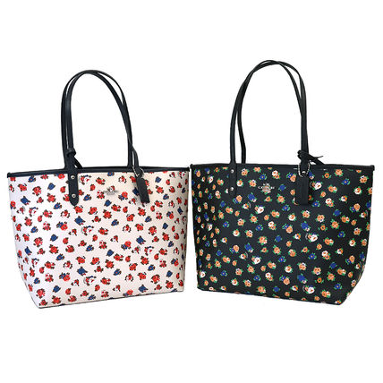 3-5 days at COACH Pouch with reversible tote F57668