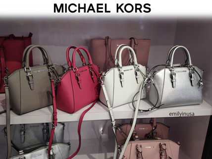 Michael Kors made CIARA MK charm with 2 *