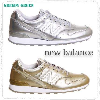 new balance 996 gold silver sneakers