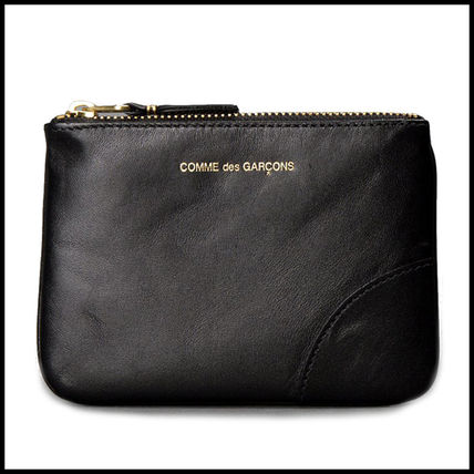 popular COMME DES GARCONS black leather coin holders