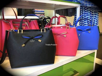 cute Kate spade bow with 2 bags gywn