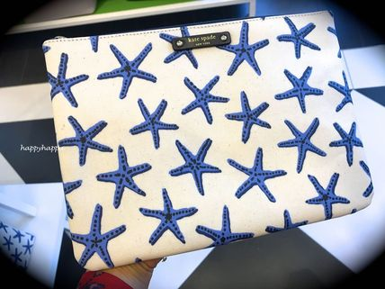 Kate spade spring resort like Starfish pattern Pouch gia