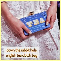 kate spade /clutch / down the rabbit hole english tea clutch