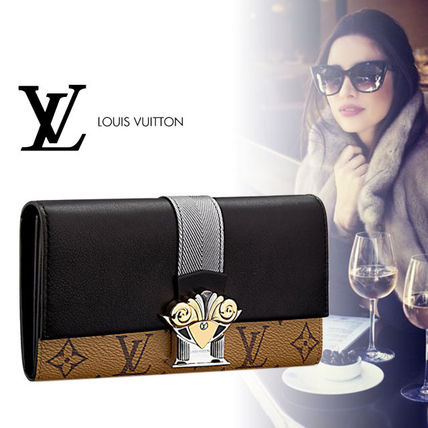 Louis Vuitton Monogram & leather wallet Sarah