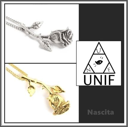 See UNIF metal & gold rose necklace