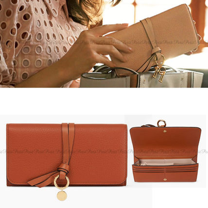 Magazine s Chloe ALPHABET charms with flap long wallet