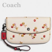 Coach/clutch in glovetanned leather with cherry print