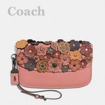 Coach/ clutch in glovetanned leather with tea rose