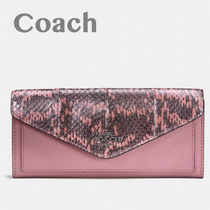 Coach/ soft wallet in color Brock snake