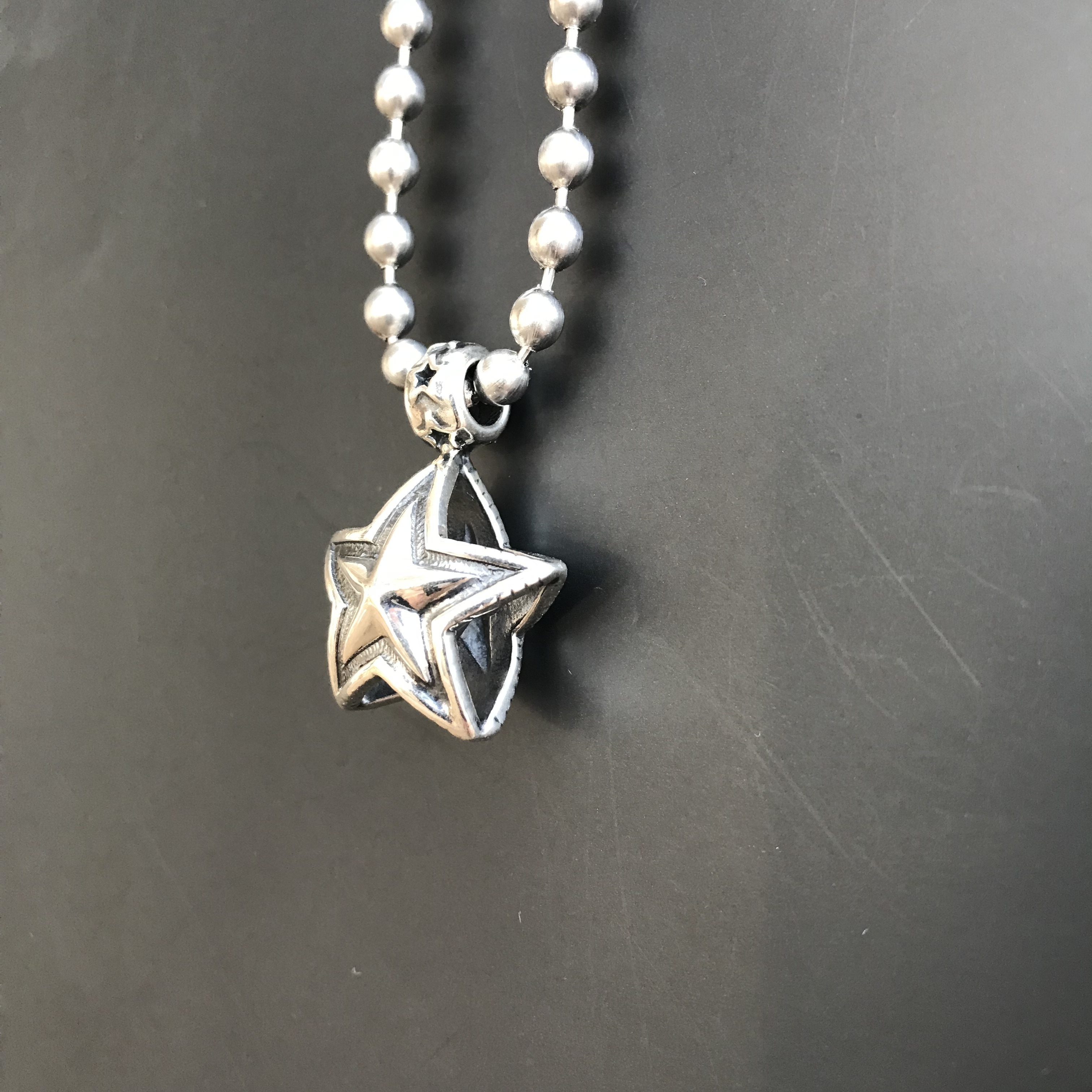 Pendant Double Sided Faceted Star Bead