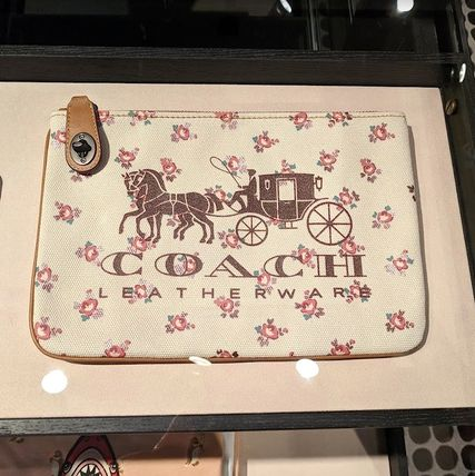 COACH 25619【日本完売】Horse And Carriage Turnlock Pouch 26
