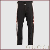 GUCCI Button-fastening Web-trimmed jersey track pants パンツ