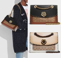 Coach ◆ 29416 Parker with border rivets and snakeskin