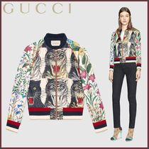 GUCCI(グッチ) Bomber in seta con stampa patchwork
