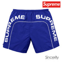 SUPREME ARC LOGO WATER SHORT / ROYAL / LARGE