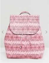 Pieces(ピーシーズ) マザーズバッグ Pieces Coloured Snake Print Backpack