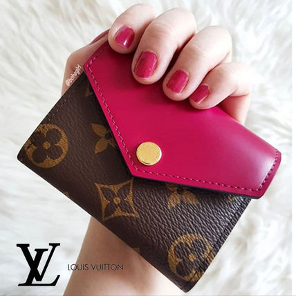 premium selection c2942 2426e Louis Vuitton(ルイヴィトン) ポルトフォイユ・ゾエ レッド